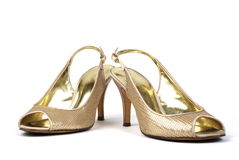 Gold  Women's High-Heel Shoes. Pair of gold women's high-heel shoes against white background Stock Photography