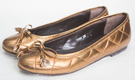 Gold Women's Shoes Royalty Free Stock Images