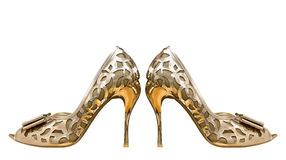 Gold women shoes isolated on white background. Royalty Free Stock Images