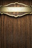 Gold on wood Stock Photo