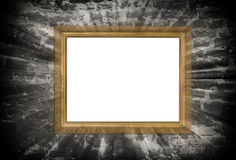 Gold wooden frame with light beams. Over ruined brick wall Stock Photography