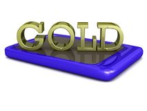 Gold word on touch screen phone tablet Royalty Free Stock Image