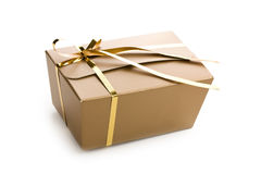 Gold wrapped gift Stock Image