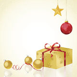 Gold Wrapped Gift on Reflection Royalty Free Stock Image