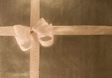 Gold Wrapping Paper with Bow Stock Photos