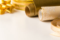 Gold wrapping paper and bow Christmas decoration Stock Images