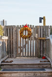 Gold Christmas Wreath on Gate to Beach Stock Image