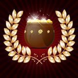 Gold wreath and pot of shiny gold Royalty Free Stock Photography
