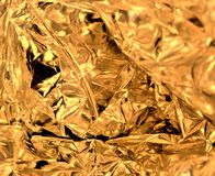 Gold wrinkled foil texture royalty free stock images