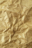Gold wrinkled paper texture abstract background Stock Photo