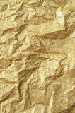 Gold wrinkled paper texture abstract background Royalty Free Stock Photos