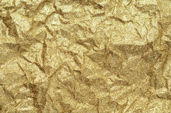 Gold wrinkled paper texture abstract background Stock Photos