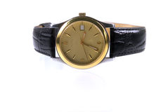 Gold wrist watches. With white background Stock Image