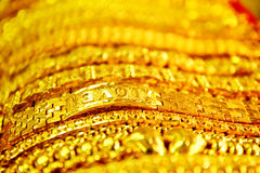 Gold wristband Stock Photography