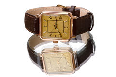 Gold wristwatch with strap Royalty Free Stock Image