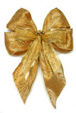 Gold Xmas Bow. Gold Christmas gift bow with little jingle bells on white Royalty Free Stock Photos