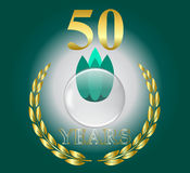 Gold 50 years celebration laurel leaf wreath with glass ball in middle on green background Royalty Free Stock Photos