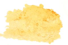 Gold yellow acrylic blob. Isolatet yellow spot stock photo