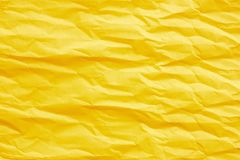 Gold yellow crumpled paper. For background royalty free stock images