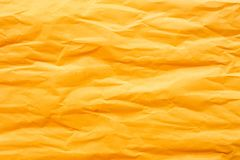 Gold yellow crumpled paper. For background stock photos