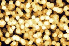 Gold yellow defocused bokeh christmas lights Royalty Free Stock Photos