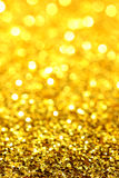 Gold/Yellow Glitter. Macro photo with selective/gradient focus of gold/yellow glitter Stock Images