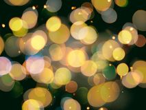 Gold yellow round blurred festive lights with sparkling effect o stock images