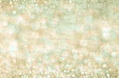 Gold and Yellow Sparkling Lights Background. White and Gold Lights Background Royalty Free Stock Image