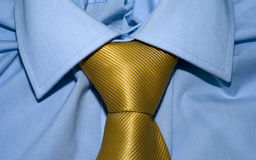 Gold yellow tie and blue shirt royalty free stock photo