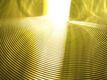 Gold yellow vertigo swirls circles grooves. Photo of gold or yellow vertigo swirls circles grooves with light dancing and being refracted from its surface Royalty Free Stock Photo