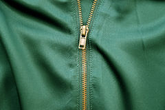 Gold Zipper on Green Silk Cloth Stock Image