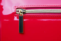 Gold Zipper of Red Purse Stock Photo