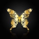 Goldabstrakter Schmetterling auf schwarzem Hintergrund Lizenzfreie Stockfotos