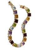 Goldarmbänder und kostbare Steine Lizenzfreies Stockfoto