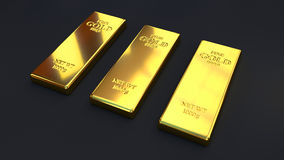 Goldbarren auf schwarzen Hintergründen Stockbilder