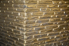Goldbarren background. brick wall for designer Stock Images