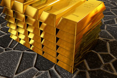 Goldbars stack on the paving sidewalk Royalty Free Stock Image