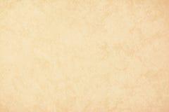 Goldbeschaffenheits-Hintergrundpapier in der gelben Weinlesecreme oder in der beige Farbe, Pergamentpapier, abstrakte Pastellgold Stockfotografie