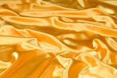 Goldbeschaffenheitshintergrund stockbild
