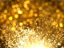 Goldbokeh Hintergrund Stockfotografie