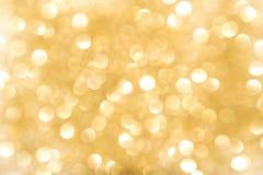 Goldbokeh Hintergrund Der Hintergrund mit boke Stockbild