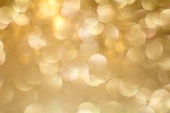 Goldbokeh Hintergrund Der Hintergrund mit boke Abstrakte Beschaffenheit Illustrationsentwurf über einem weißen Hintergrund verwis Lizenzfreie Stockbilder