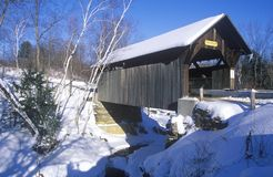 The Goldbrook Covered Bridge in Stowe, Vermont during the winter stock photography