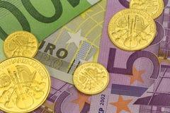 Goldcoinsbankbiljetten 4 Stock Afbeelding