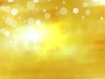 Golddefocused Leuchtehintergrund Lizenzfreies Stockbild