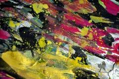 Golddunkelrotes verwischt spritzt, bunte klare wächserne Farben, kreativer Hintergrund der Kontraste Lizenzfreie Stockbilder