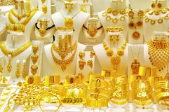 Golded jewel in a shop royalty free stock photo