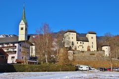 Goldegg castle and church, Austria, Europe. Goldegg castle and church St. George in in Goldegg, Austria, Europe, in winter. Both buildings were erected in the royalty free stock photography