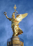 Goldelse, atop the Victory column, Berlin. Glinting in the sun, the winged golden statue of Goldelse, at the top of the victory column in Berlin Stock Photo