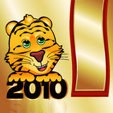 Golden 2010 Tiger. Happy tiger cub celebrates 2010 with a golden banner Stock Photo